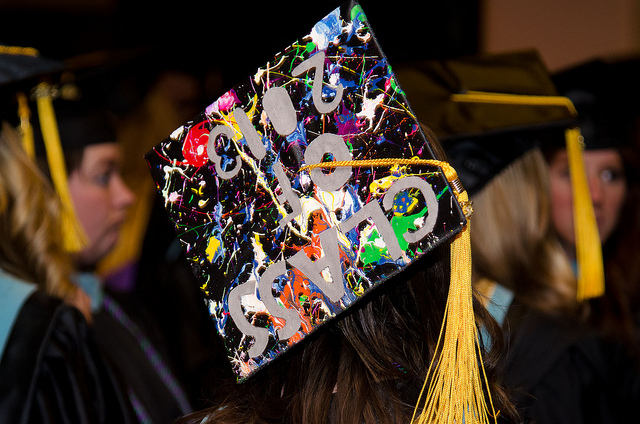 college graduate at graduation with painted cap