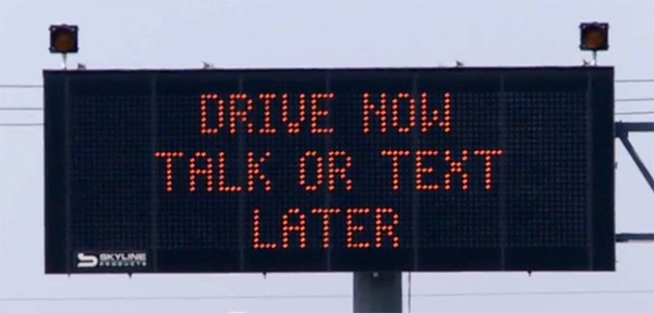 drive now talk or text later electronic sign psa