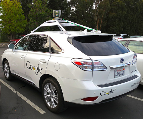 white Google self driving car, parked