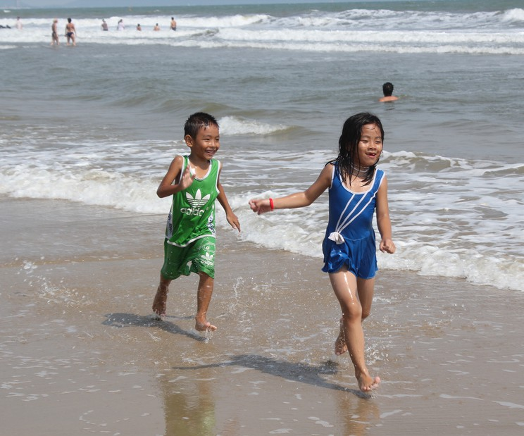 kids running on beach, family vacation