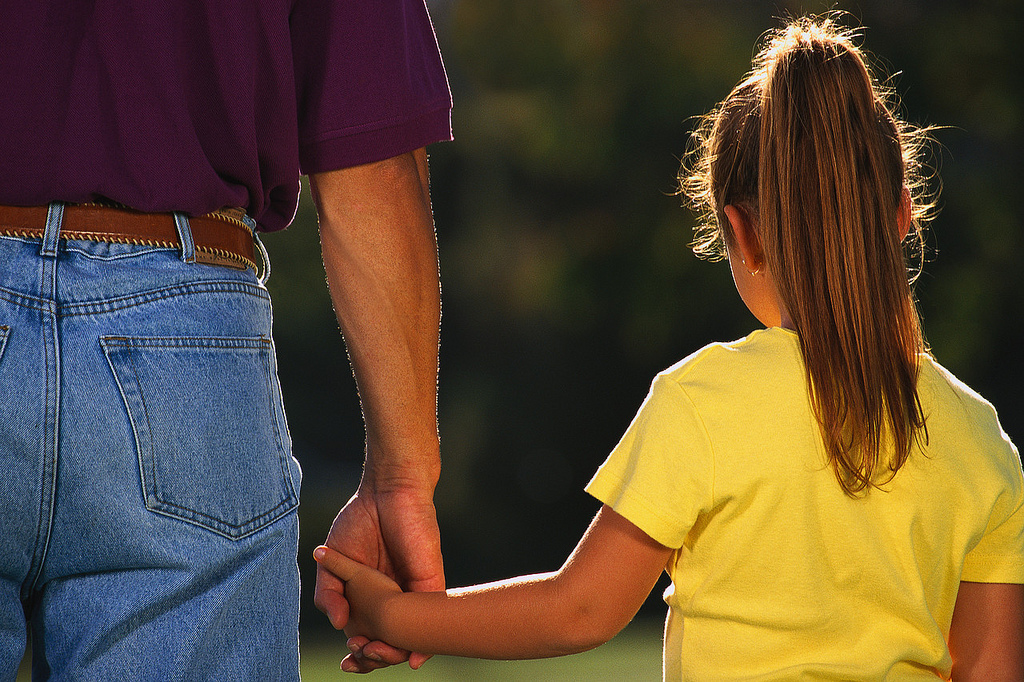 father holding daughters hand, father daughter