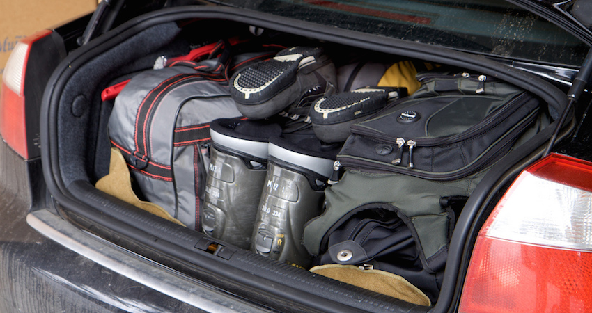 car trunk packed with luggage and ski boots