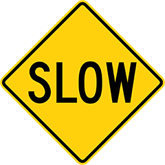 slow driving yellow sign