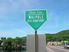 state line road sign walpole new hampshire green