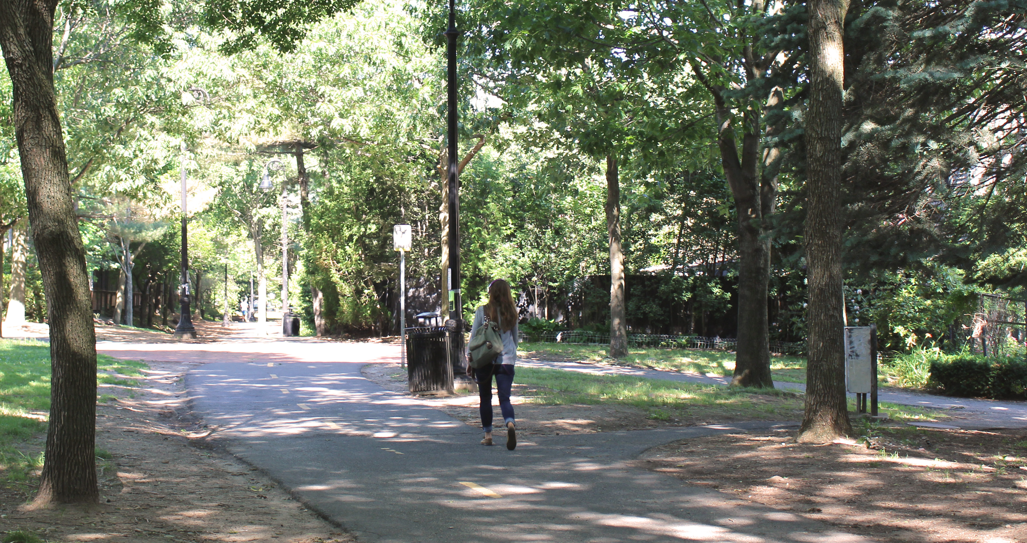 girl walking on a path in a park