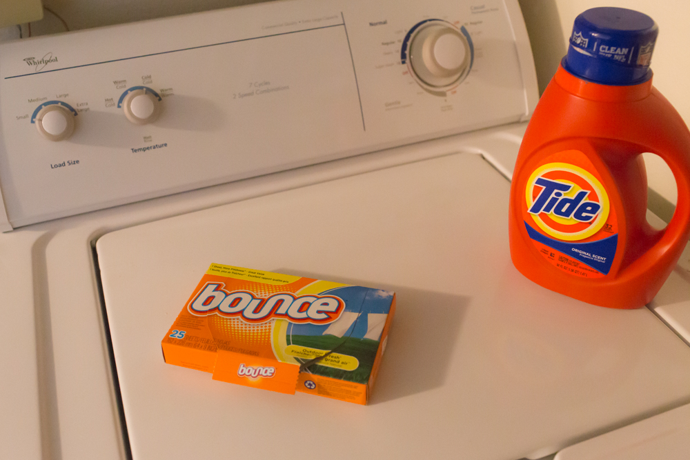 dryer sheets and laundry detergent on washing machine